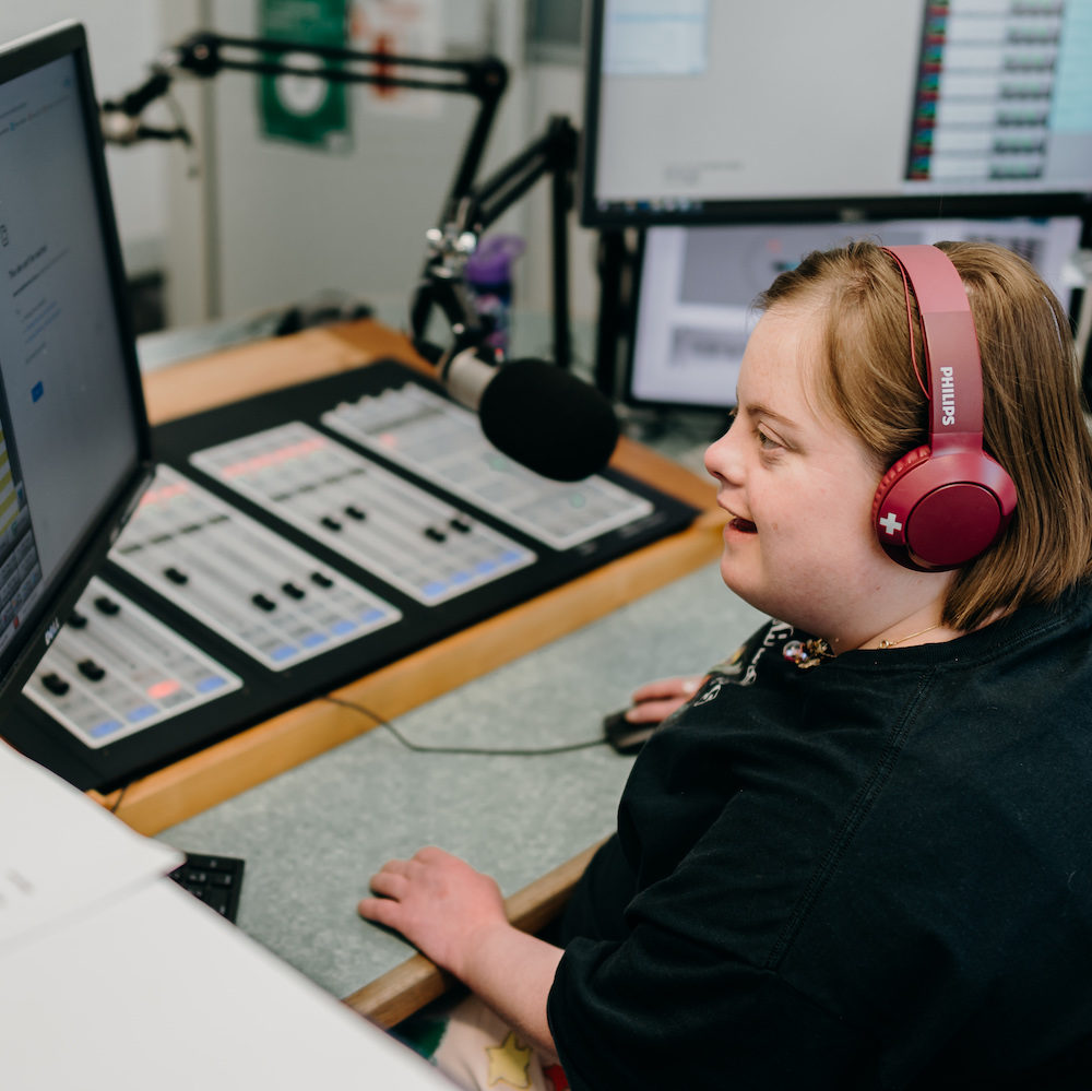young woman working in radio announcing